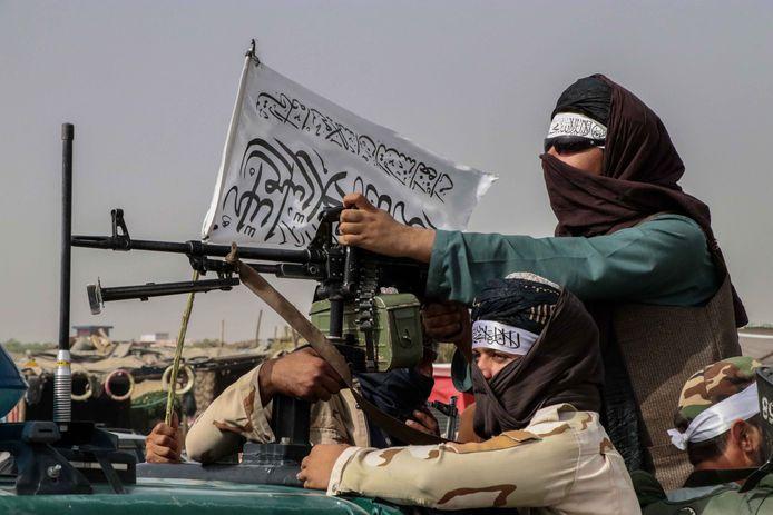 Talibanstrijders in Kandahar, een van de laatste steden die vielen vóór hoofdstad Kaboel.