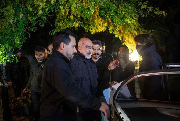 Ahmet Alta (midden) is opnieuw opgepakt. Beeld AFP