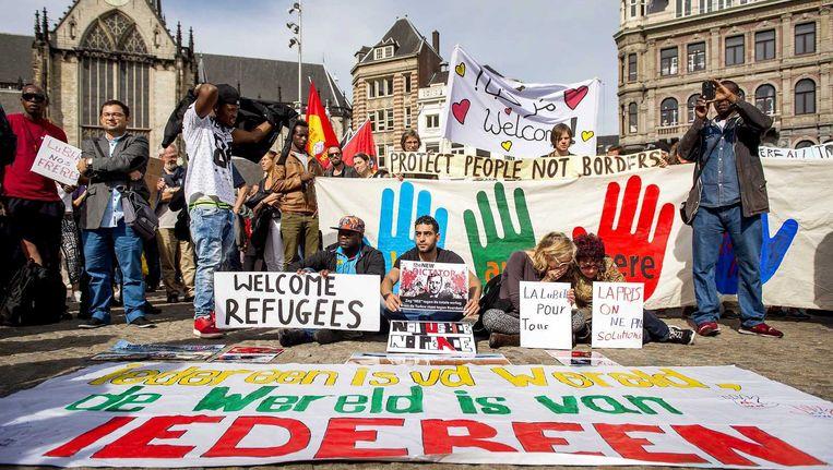 Betogers tijdens de demonstratie Vluchtelingen Welkom op de Dam, sept. 2015 Beeld anp