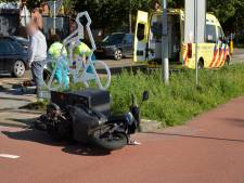 Bezorgscooter aangereden op kruising in Breda
