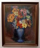 Het schilderij 'Margrieten op blauwe vaas'.