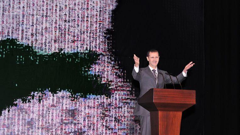 Bashar al-Assad tijdens zijn toespraak vandaag. Beeld EPA