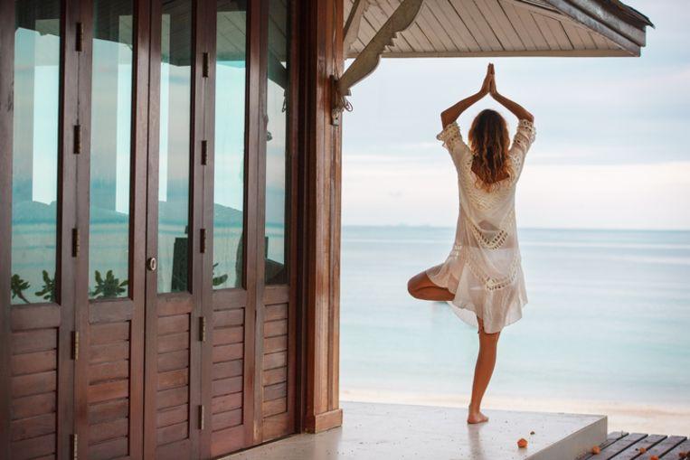 Yoga op een exotische locatie: het is een van de populairste reisformules voor 2018. Beeld Thinkstock