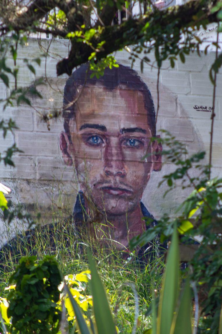 Een muurschildering toont de vermiste Hermey Mejia. Zijn broer Juan Diego zegt: 'Eerst dachten we dat de verdwijningen geïsoleerde gevallen waren. Later kregen we door dat het er niet één, maar velen waren.' Beeld Ynske Boersma