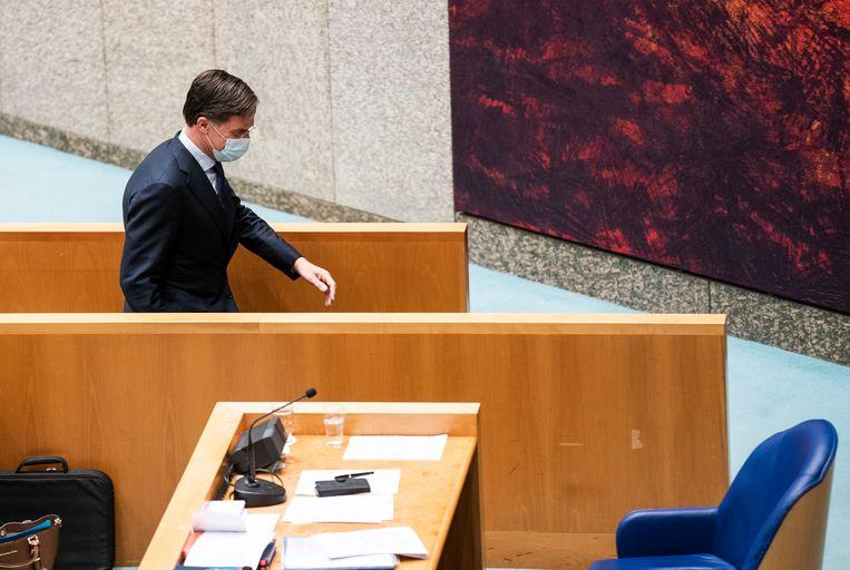 Premier Rutte tijdens een schorsing van het debat over het onvolledig informeren van de Tweede Kamer in de toeslagenaffaire.  Beeld Freek van den Bergh / de Volkskrant