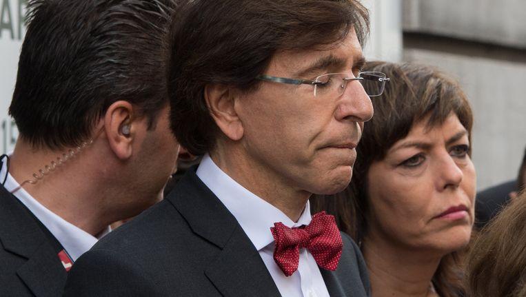 Premier Di Rupo en Joëlle Milquet tijdens een herdenkingsplechtigheid bij het Joods Museum in Brussel. Beeld BELGA