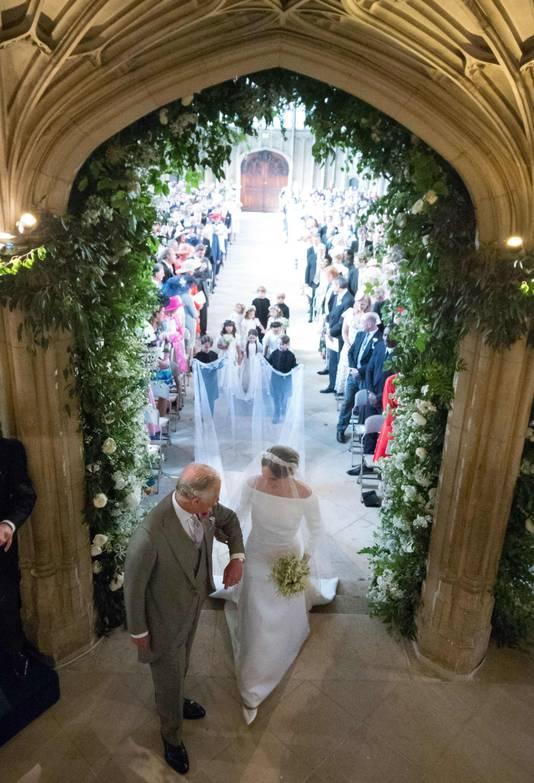 Prins Charles bracht Meghan uiteindelijk naar het altaar.