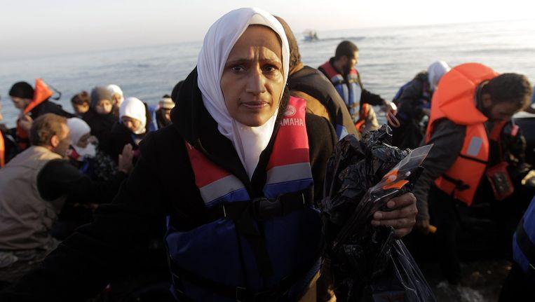 Bootvluchtelingen komen aan op het Griekse eiland Lesbos. Beeld epa