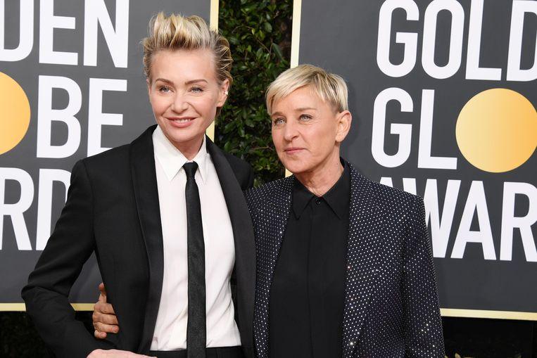 Ellen DeGeneres (r) met haar vrouw Portia de Rossi. Beeld Photo News