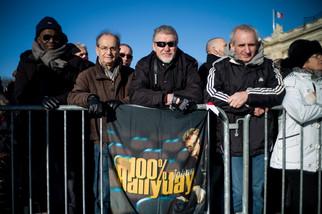 fotoreeks over Tienduizenden mensen nemen afscheid van Johnny Hallyday