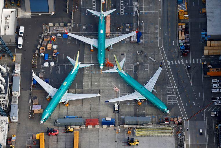 Een aantal Boeing 737 MAX-toestellen staan geparkeerd bij de Boeing-fabriek in Renton, Washington. Beeld REUTERS