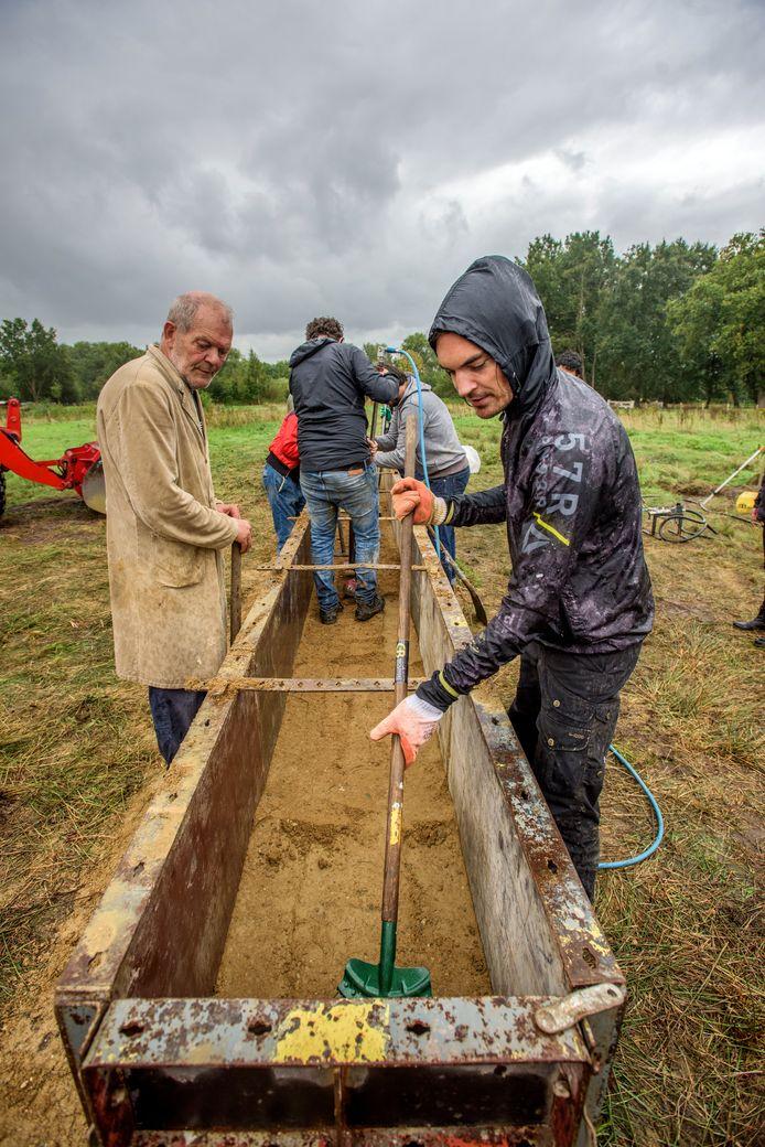 Bouw Lemen Muren voor Landschaps Kunstproject