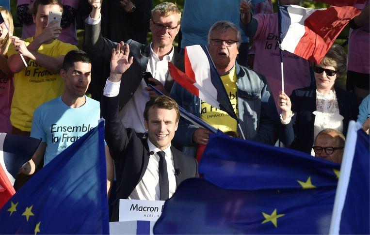 Zelfs president Macron luistert naar de analyses van DSK. 'Ze hebben elkaar minstens twee keer ontmoet.' Beeld Belgaimage