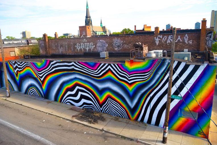 Een ander muurwerk van Pantone, dat de titel 'Chromadynamica For Detroit' draagt. Beeld rv Felipe Pantone