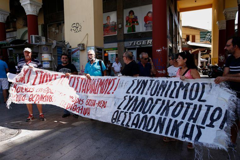 Protest in Athene tegen de gedwongen veiling van huizen, waarvan de hypotheek niet is betaald. Beeld Getty Images
