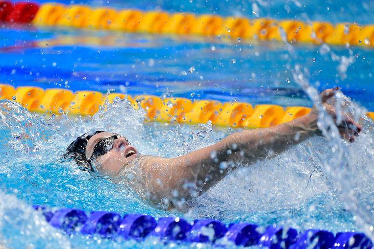 Maaike de Waard tijdens de halve finale 100 meter rugslag. Beeld AFP