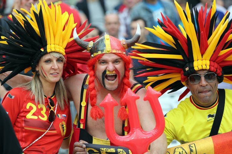 Archiefbeeld van supporters van de Rode Duivels tijdens de wedstrijd tegen Zweden op het vorige WK in 2014. Beeld BELGA