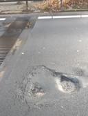 Het afgelopen weekend gerepareerde gat in het wegdek van de N65.