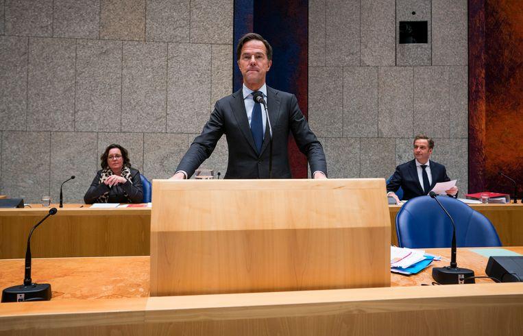 Premier Mark Rutte tijdens een debat over de ontwikkelingen rondom het coronavirus.  Beeld Freek van den Bergh / VK
