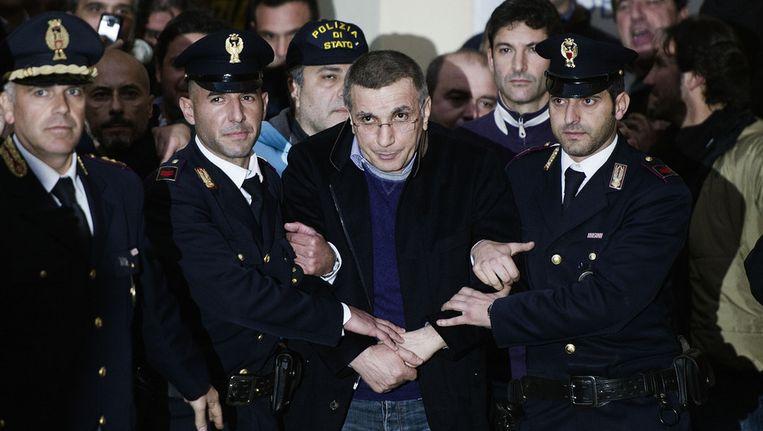 Michele Zagaria (53) tojdens zijn arrestatie. © afp Beeld