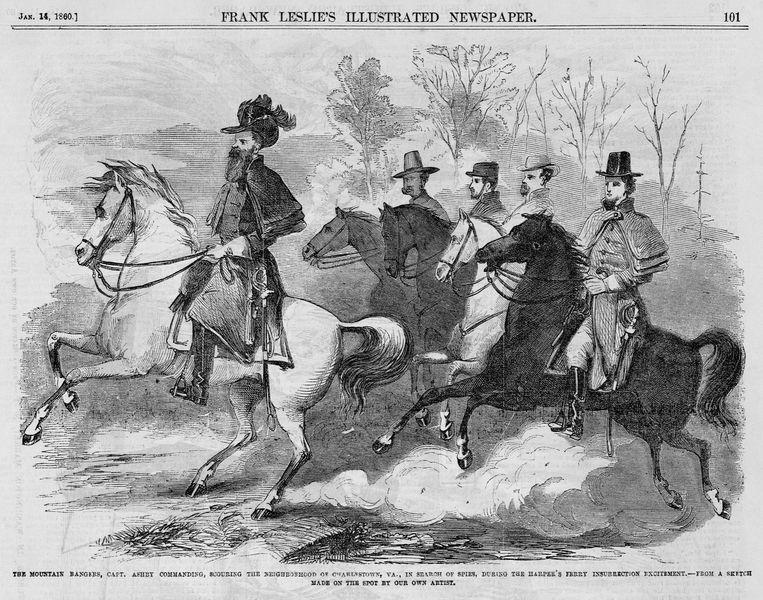 Kolonel Turner Ashby  (links) te paard, in 1860. In de Amerikaanse Burgeroorlog zou hij worden bevorderd tot generaal.  Beeld Corbis via Getty Images