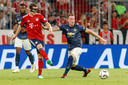 Sebastian Rudy (met masker) in actie tegen Manchester United.