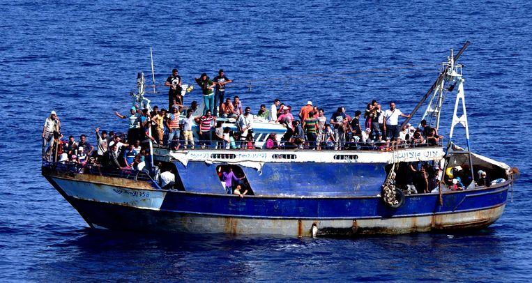 'Bootvluchtelingen zijn op GeenStijl 'dobbernegers'' Beeld afp