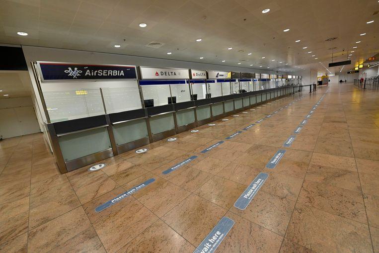 Een lege vertrekhal in Brussels Airport. Beeld Photo News