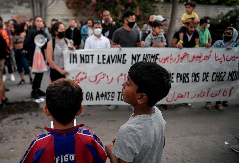 Kinderen tijdens een demonstratie in Athene deze maand.  Beeld AFP