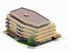 Okergeel appartementencomplex maakt de tongen los: 'Passend, zo'n doodskist naast een begraafplaats'