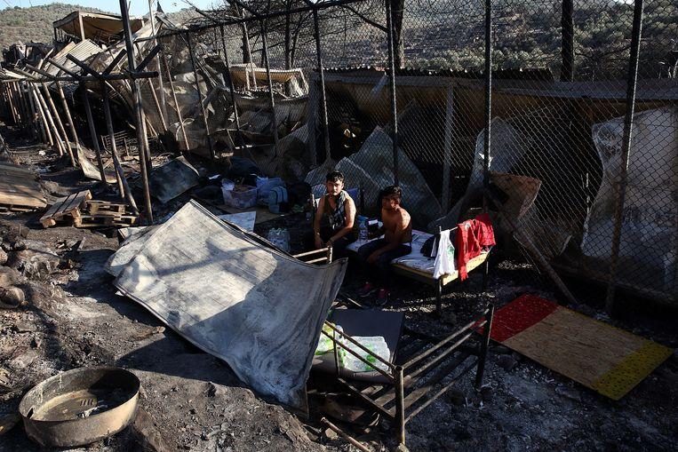 De resten van afgebrand vluchtelingenkamp Moria. Beeld Hollandse Hoogte / EPA