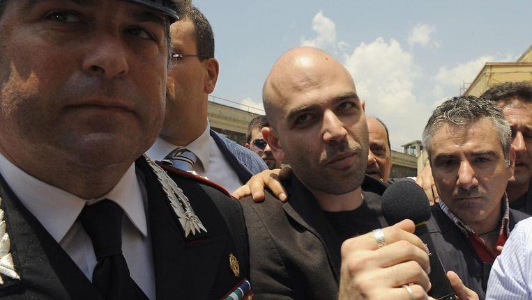 Roberto Saviano, de schrijver die met zijn boek Gomorra de Napolitaanse maffia volop in de schijnwerpers zette. Beeld afp