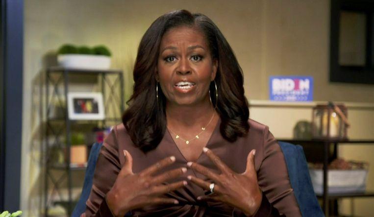 De voormalige first lady Michelle Obama tijdens de eerste dag van de Nationale Democratische Conventie. Beeld REUTERS
