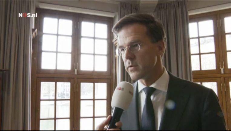 Premier Rutte in het 'Jeugdjournaal': 'Niemand wordt in dit land zomaar uitgezet.' Beeld NOS