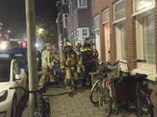Woningen in Bezuidenhout ontruimd door brand, politie onderzoekt brandstichting