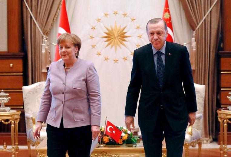 De Duitse bondskanselier Angela Merkel en de Turkse president Recep Tayyip Erdogan. Beeld AFP