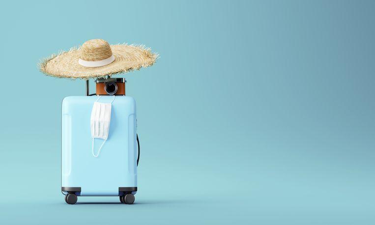 In vliegtuig met mondkapje Beeld Shutterstock