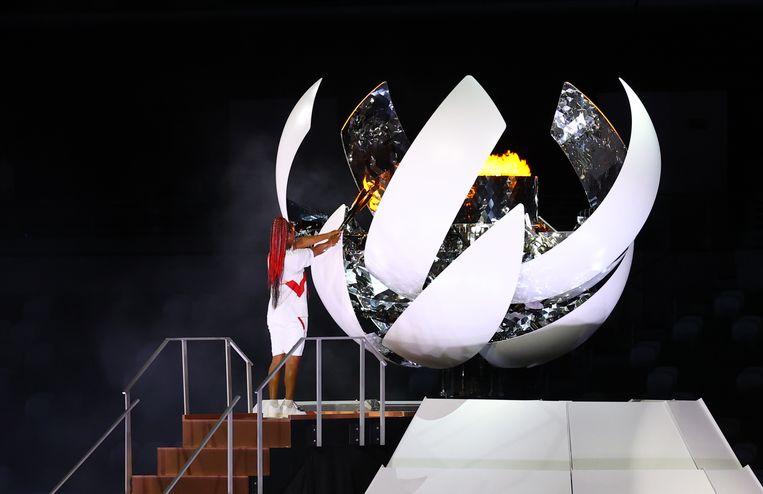 Naomi Osaka ontsteekt het Olympisch vuur.  Beeld Reuters