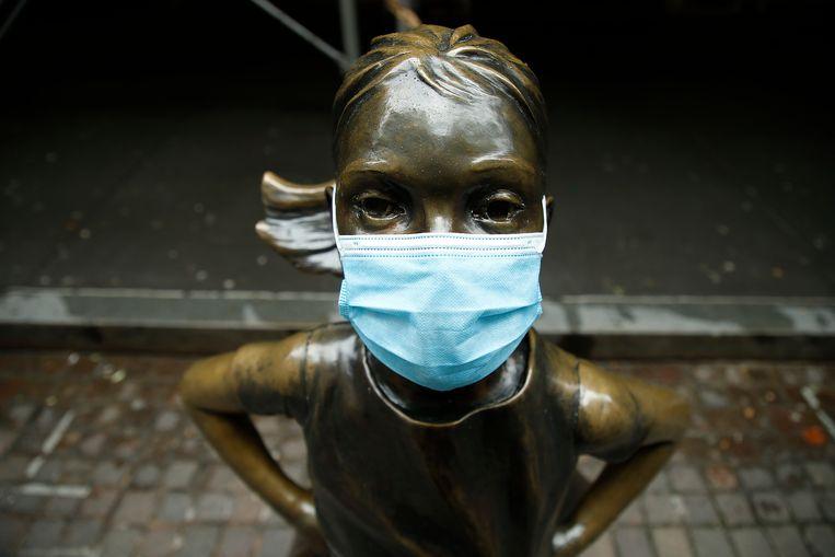 'Fearless Girl', bronzen beeld in de financiële wijk van New York. Beeld Getty Images