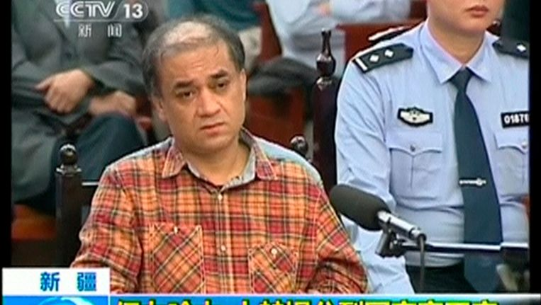 Ilham Tohti tijdens de rechtszaak. Beeld REUTERS