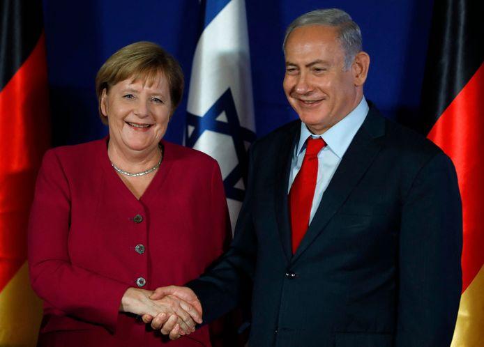 De Duitse bondskanselier Angela Merkel naast de Israëlische premier Benjamin Netanyahu op een foto uit 2018.
