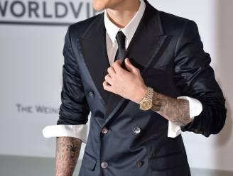 Stiekemerd: Justin Bieber neemt borst Heidi Klum vast