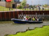 Kano's slaan om in Biesbosch bij Drimmelen, iedereen veilig aan wal