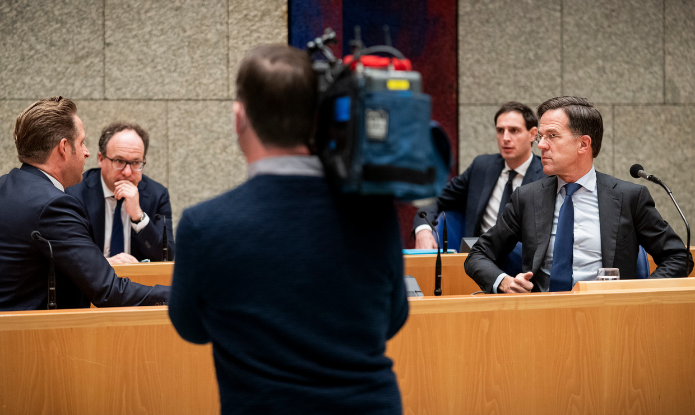 Ministers Hugo de Jonge, Wouter Koolmees, Wopke Hoekstra en premier Mark Rutte. Beeld Freek van den Bergh / de Volkskrant