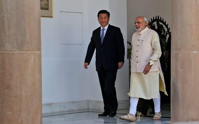 De Indiase premier Modi met de Chinese President Xi Jinping. Beeld ap