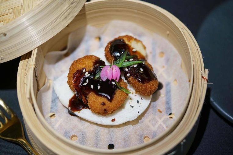 De kweekvleesnuggets in Singapore. Beeld AFP