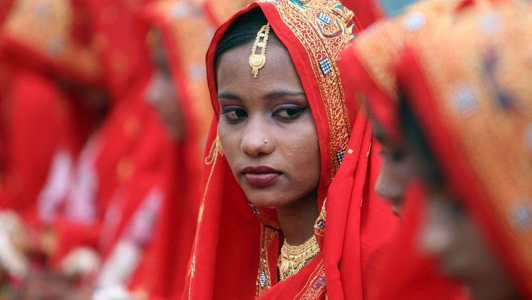 Een Pakistaanse arme bruid op een massa-huwelijk. Beeld epa