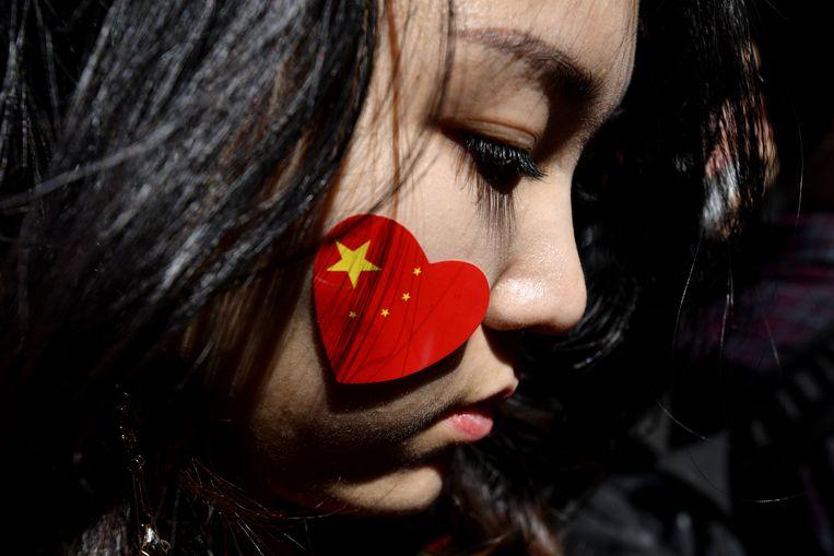 Een pro-China demonstrant in Sidney. Beeld AFP