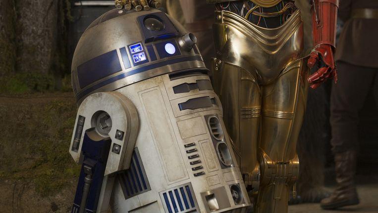 R2-D2 (links) met C-3PO, eveneens een robot uit Star Wars. Beeld AP
