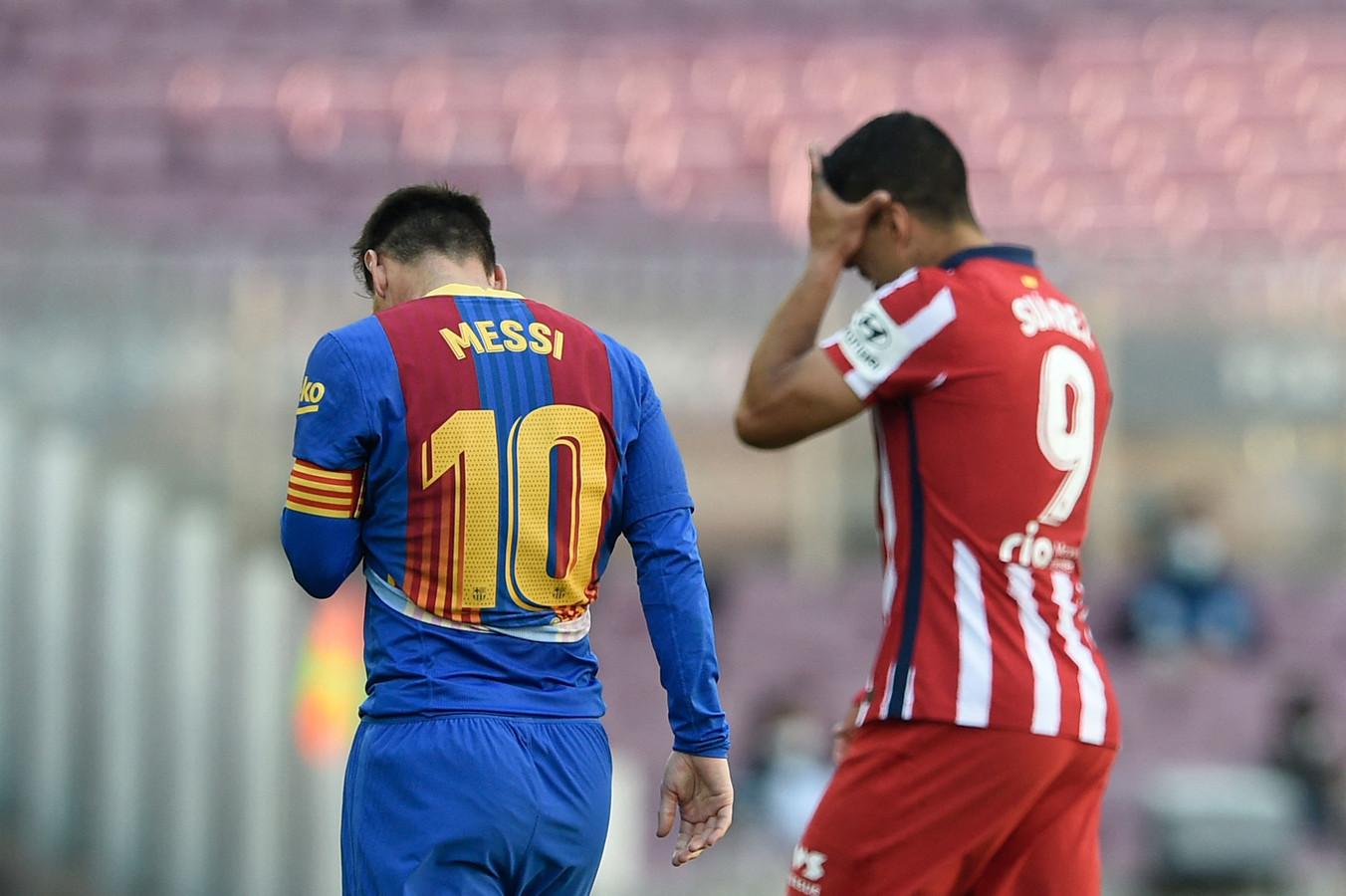 Lionel Messi (l) en Luis Suárez na het doelpuntloze gelijkspel in de kraker tussen FC Barcelona en Atlético Madrid.
